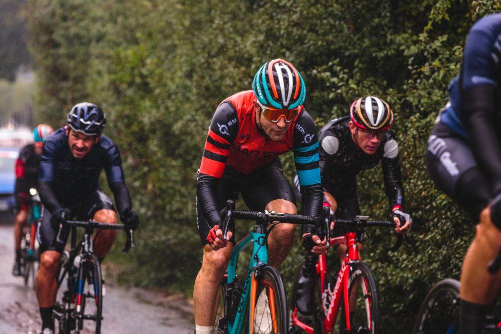 cyclists racing in the rain