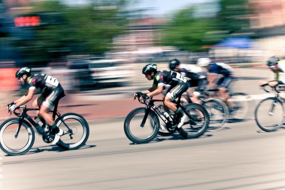 men racing bicycles