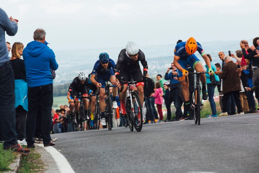 Bicycle racers cresting a hill