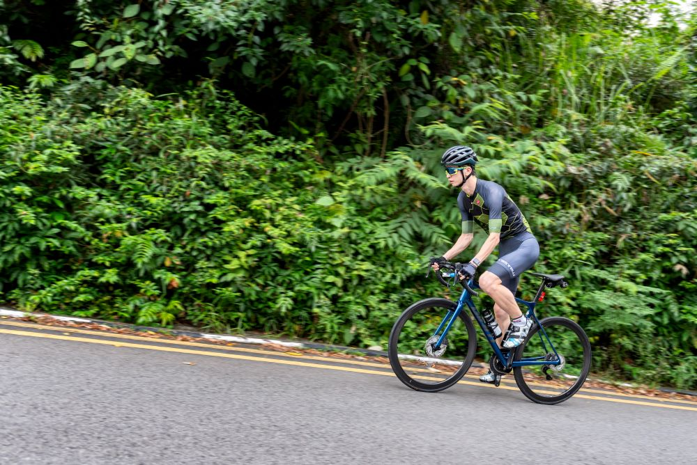 A cyclist cycling up a hill